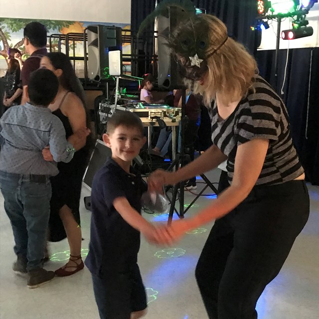 Mothers and sons have a great time dancing it out at the annual mother son dance!