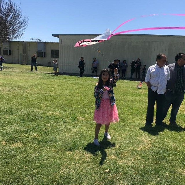 This student is excited to see her kite soar into the air!