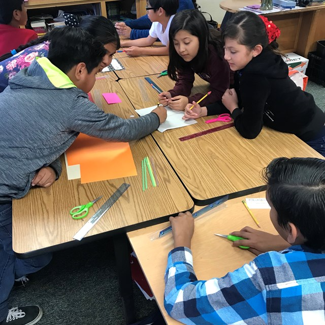 Boeing engineers challenge Violette students with an activity that they are quick to work on.