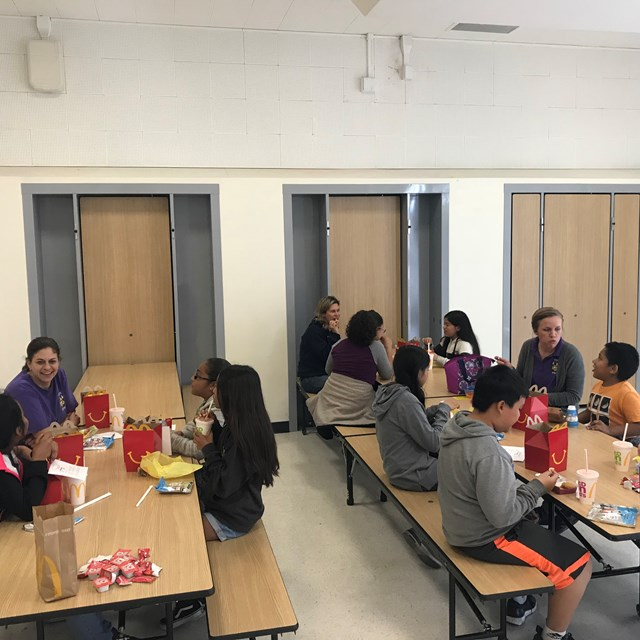 Students and teachers spend lunch together getting to know one another better as a special reward.