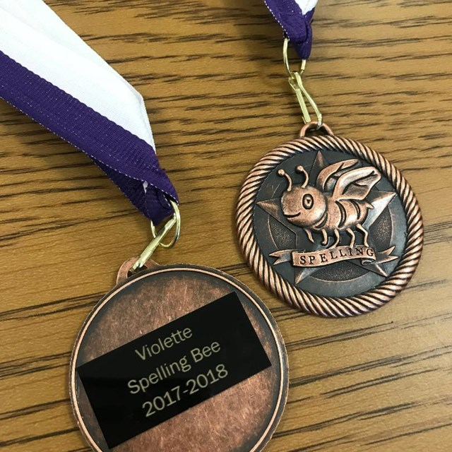 Everyone walks away a winner at Violette's spelling bee! These lovely medals are handed out to all contestants!